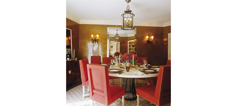 Dining room with red chairs by Brian McCarthy