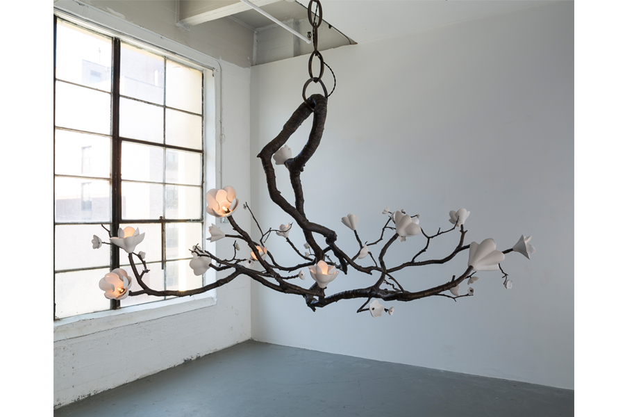 "Unique radial Branch illuminated sculpture in bronze with porcelain magnolia and cherry blossoms. Designed and made by David Wiseman, USA, 2015. 82"" L x 71"" W x 43"" H / 208.3cm L x 180.3cm W x 109.2cm H (HL1384)."