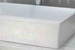 Inspired by its naturally iridescent namesake, the luminous Pearlescent glaze from DXV offers a dramatic new way to add a feeling of opulent luxury to the classic white lavatory.