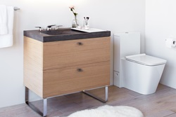 Showcasing clean, modern design, the new DXV Modulus collection includes a spacious oak wood veneer vanity, a 36-inch lavatory offered in striking concrete construction, and a one-piece toilet with a slim, high-back tank design.