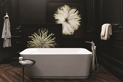 The contemporary DXV Modulus freestanding tub exhibits functional elegance with its softly angular design lines, ideal for deep soaking luxury with its 81-gallon capacity.