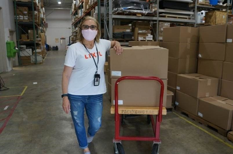 LIXIL employee Debbie Drury distributes face shields at the company's headquarters in Piscataway, N.J. to LIXIL employees across the country to distribute in their respective communities. Piscataway-based LIXIL, home to the kitchen and bath brand American Standard, recently expanded their efforts to make face shields for front line workers and teamed up with a local volunteer group called Jersey City Rapid Maker Response Group (JCRMRG) to manufacture and distribute thousands of face shields to first responders and medical workers in communities across the US battling COVID-19.  LIXIL is donating 50,000 shields to communities it serves both in its backyard in NJ and across the U.S.
