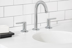 This high spout Studio S widespread faucet from American Standard features ADA-compliant lever handles for easy operation.