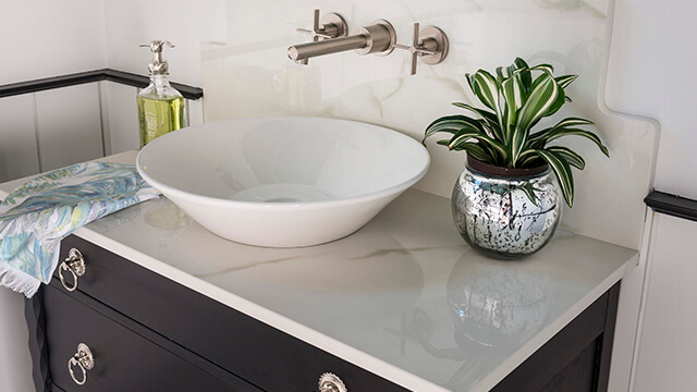 DXV Percy Wall-Mount Faucet with Cross Handles paired with American Standard Celerity Vessel Sink