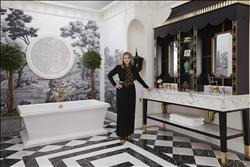 "Susan M. Jamieson, ASID, recreated the ""Southern Classic"" city of Charleston, choosing architectural elements from this locale's historic homes and marrying them with modern fixtures. Here, she placed the DXV Fitzgerald freestanding tub, with its clean design lines, directly beneath a more historically-styled Palladian spiderweb window. DXV Pop undercounter lavatories and Randall widespread faucets further complement this combination of classic and modern presentation."
